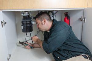 man fixing their houme's plumbing system