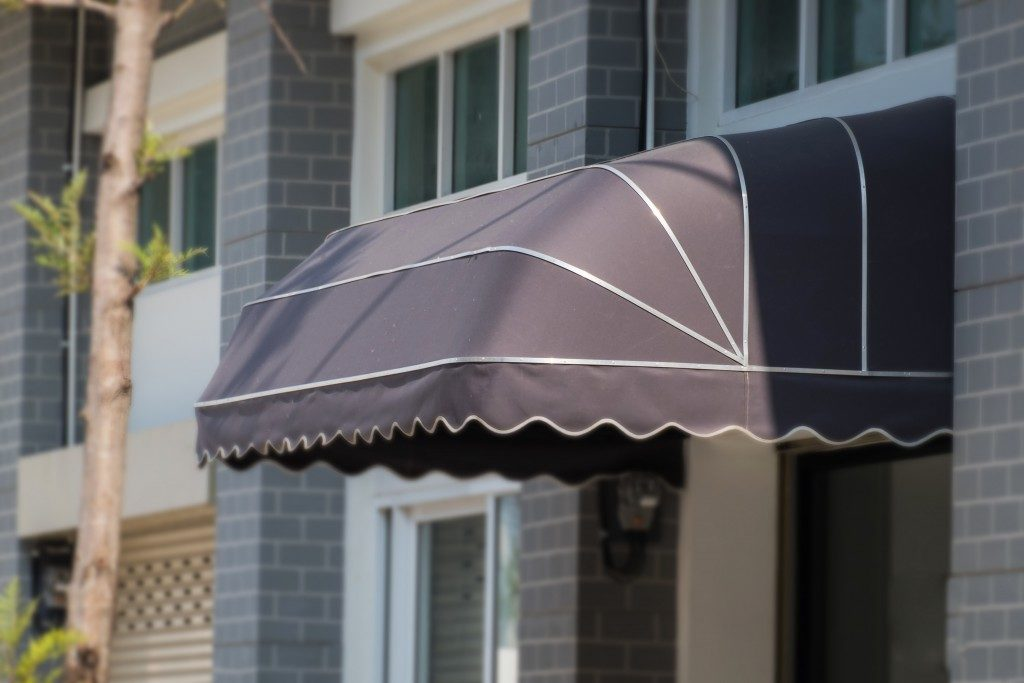 brown awning in white lines installed at the front door of a building