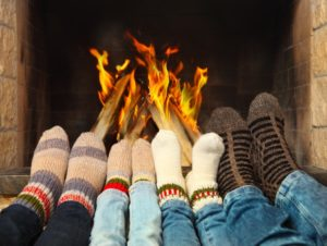 family warming near the fireplace