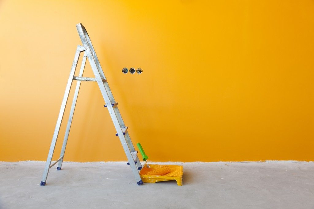 Newly painted wall with ladder
