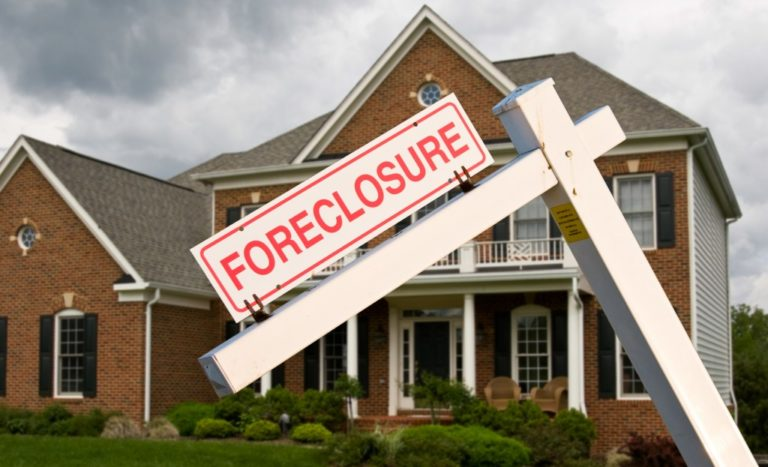 Foreclosure sign in front of a home