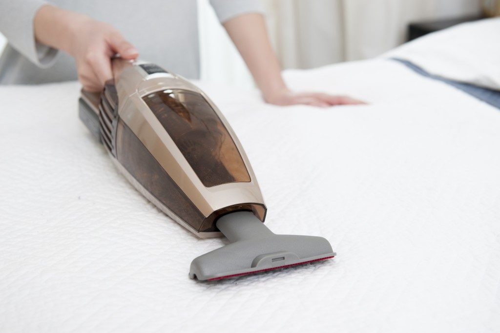 Vacuum cleaning the mattress