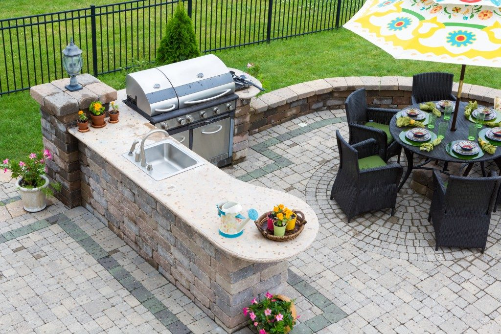 outdoor kitchen with dining table