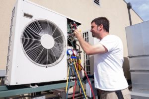 Technician fixing HVAC unit