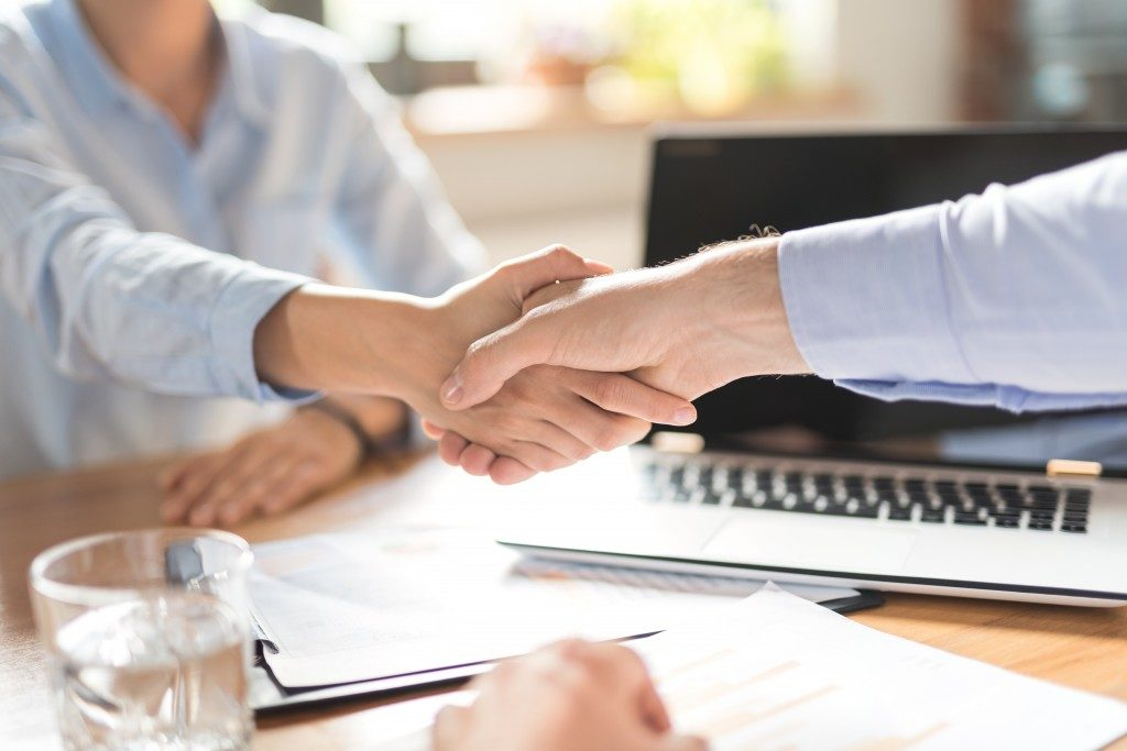 client and salesperson shaking hands