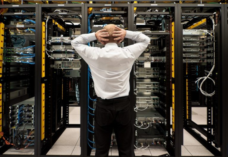 man looking at the data system