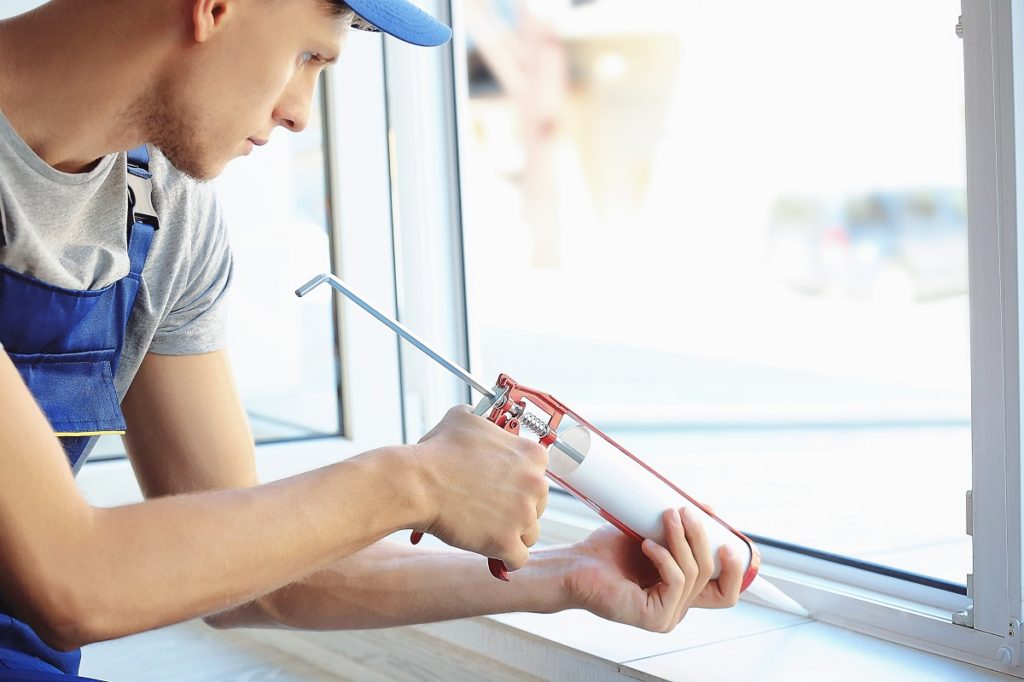 man fixing the window