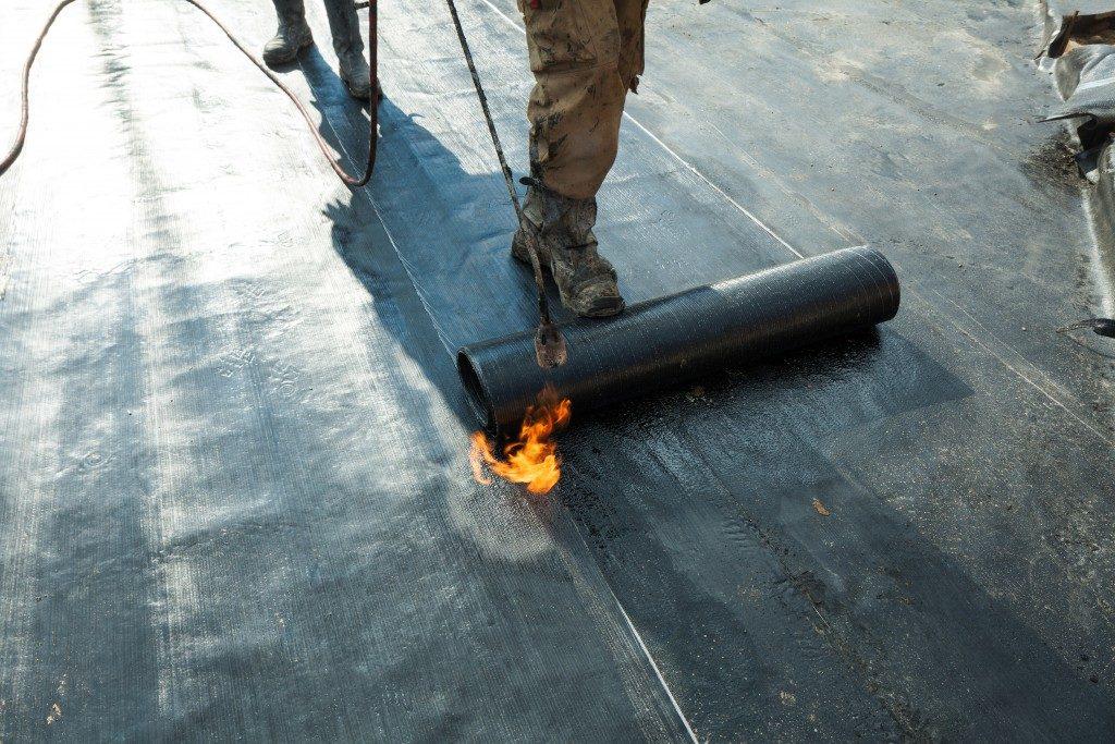 person coating a fllor
