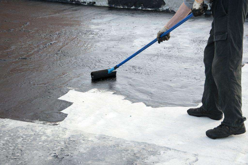 person applying waterproof coating