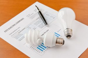 Electric bill with light bulb