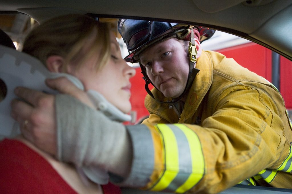 Firefighter rescuing a woman