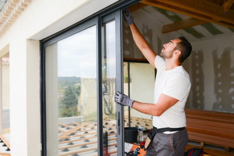 man installing glass doors