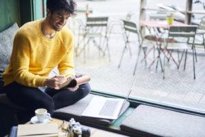 freelancer working at a cafe