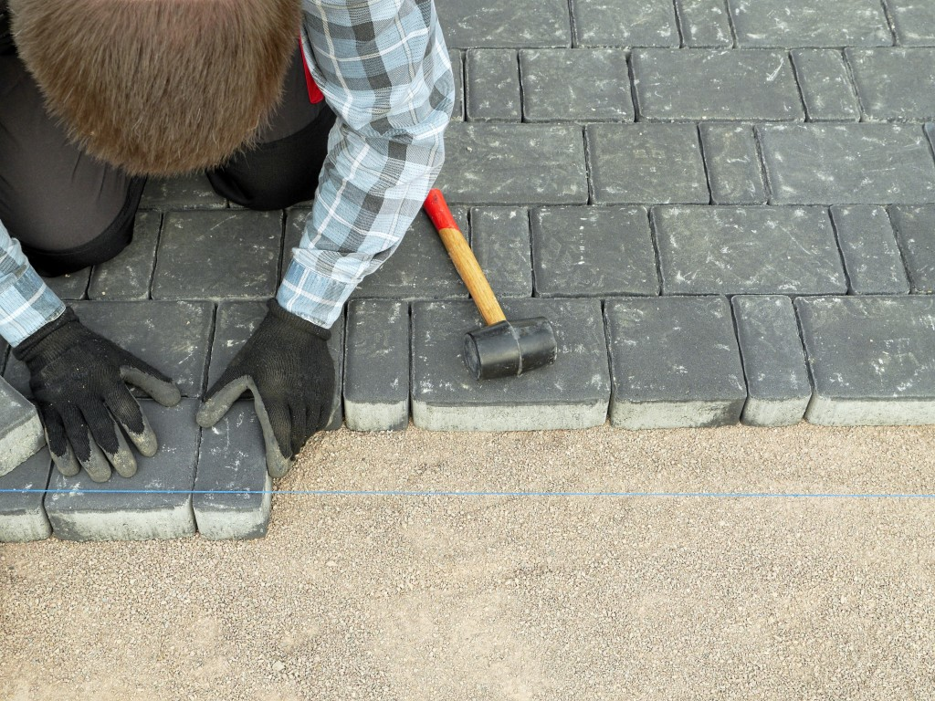 laying down pavers