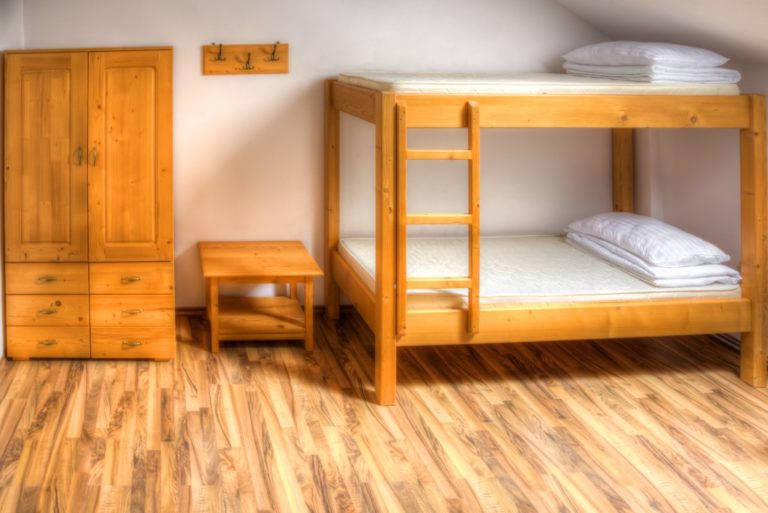 hostel with bunk bed and wooden flooring