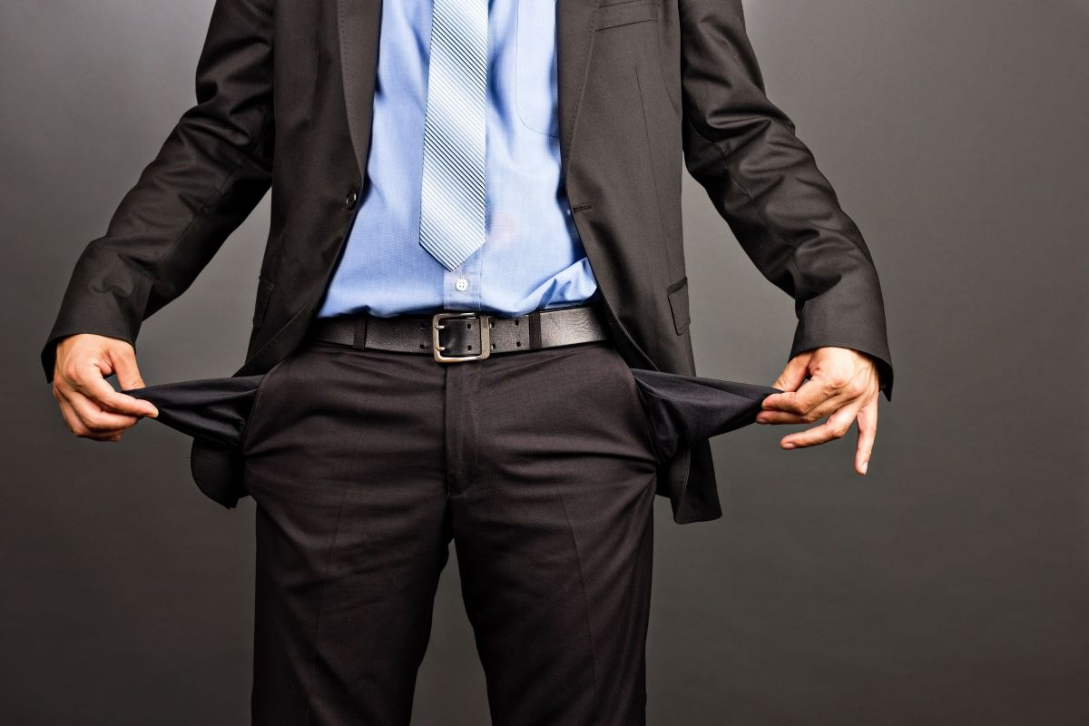 businessman empty pockets