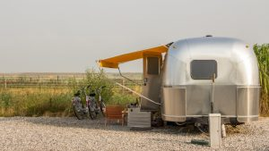 mobile home next to a plot of land