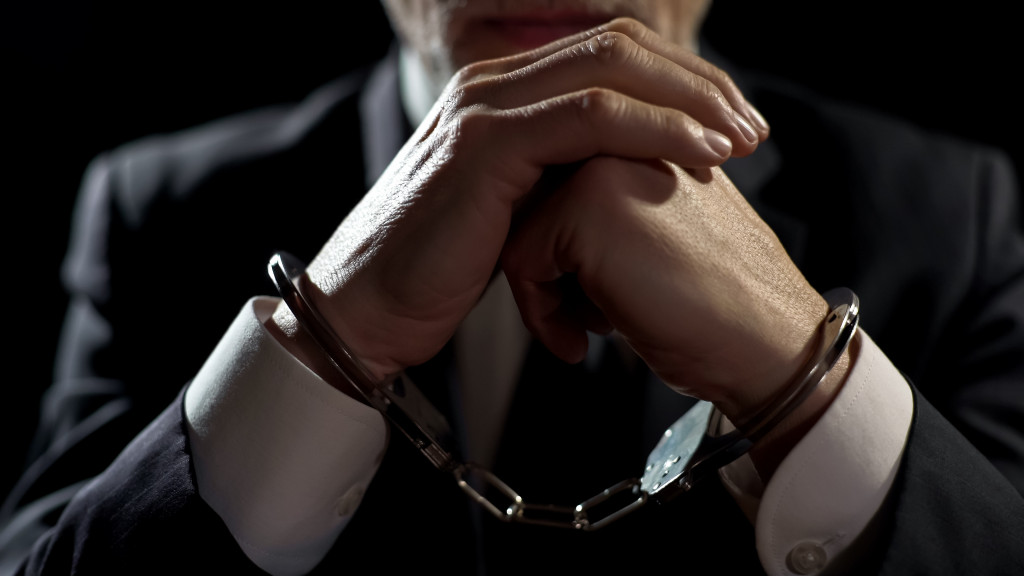 man in a suit with handcuffs