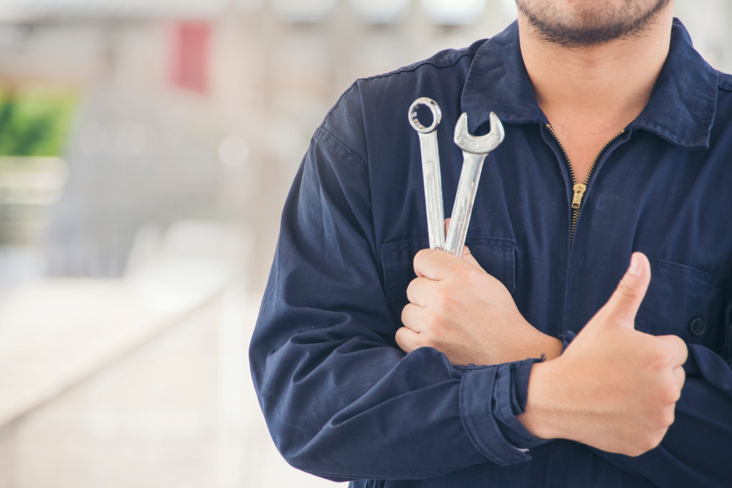car mechanic with tools